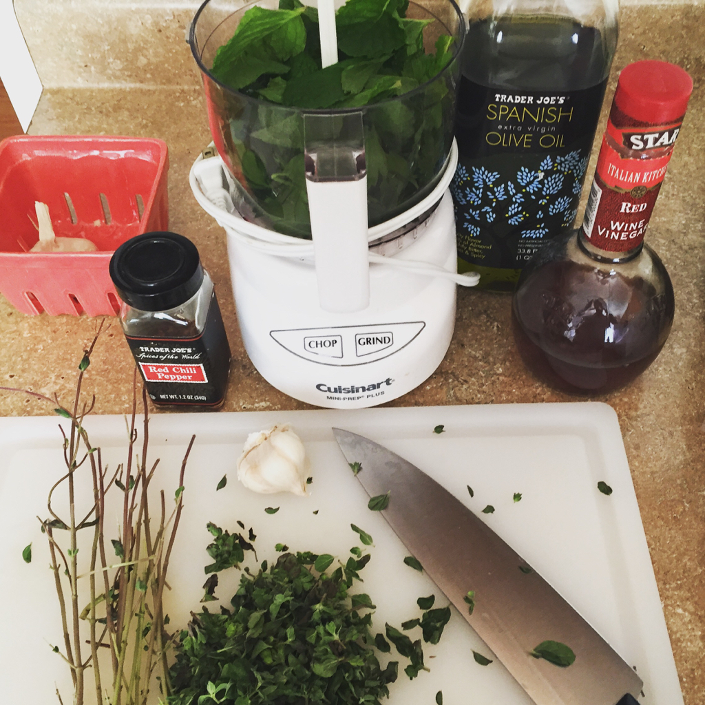 cooking with fresh herbs making chimichurri