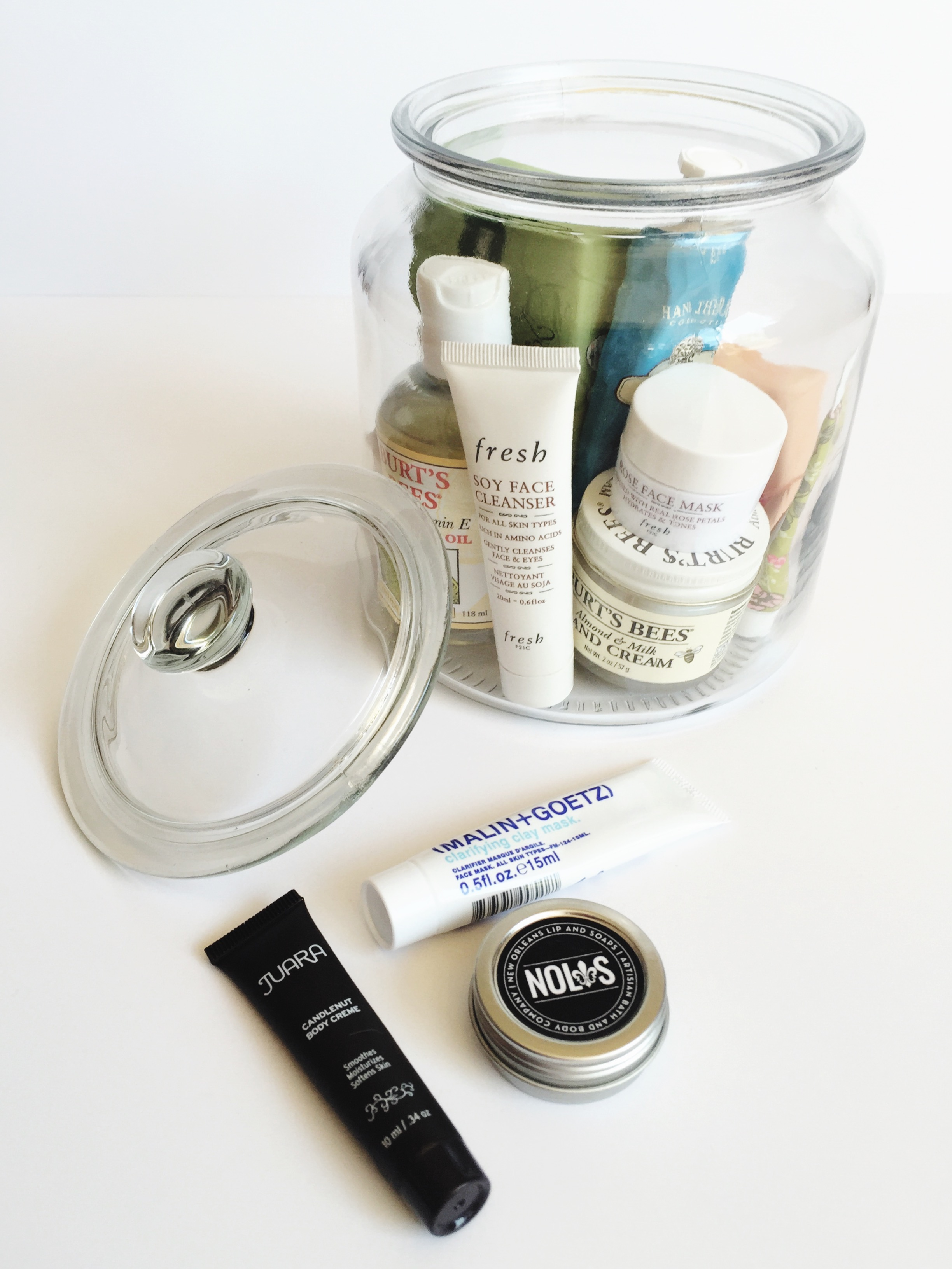 use a glass jar to corral small beauty products. it's both functional and pretty.