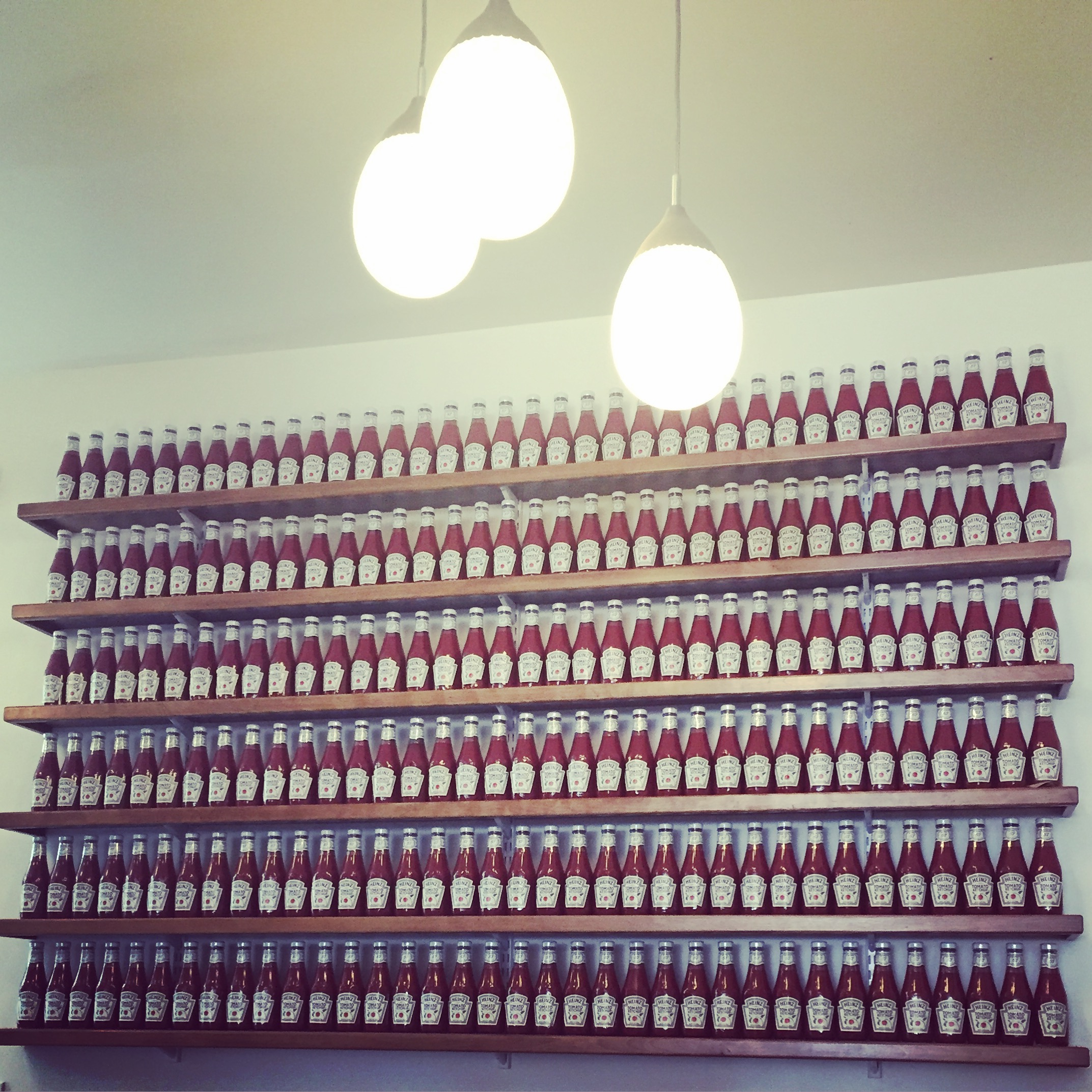 ketchup bottles on open shelving is totally art. taken at farmer boy in santa barbara, ca.